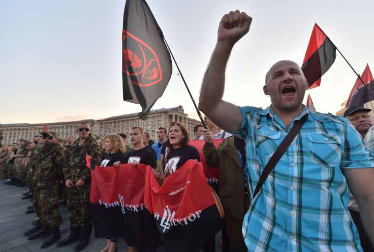 Activists and supporters of far-right Ukrainian party Right Sector participate in a rally on Independence Square in Kiev on July 21, 2015 after the party's extraordinary congress. Several thousand protesters gathered to support the party's decision to start collecting signatures for a referendum calling for for the resignation of President Petro Poroshenko and his government. AFP PHOTO/ SERGEI SUPINSKYSERGEI SUPINSKY/AFP/Getty Images