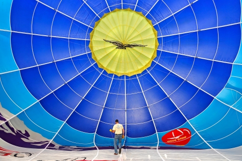 Pilot Reed Basley of Island Balloons, Inc., preps the inside of a his hot air balloon before taking to the skies near Norge Monday evening. (Photo by Jonathon Gruenke/Daily Press)