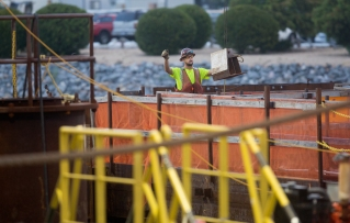 A construction employee helps prepare to submerge the eleventh and final element of the new Midtown Tunnel in the Elizabeth River on Tuesday morning in Norfolk. (Kaitlin McKeown)
