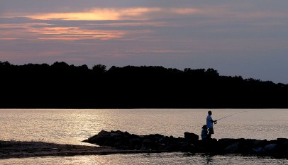 Pete Cole and Anyssa Holder get in some fishing Sunday evening as clear warm weather was the rule for most of the day. (Rob Ostermaier)