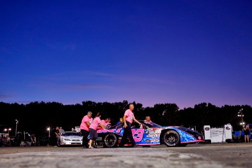 Crew members for Macy Causey push her car to the starting line during Hampton Heat 200 Saturday at Langley Speedway.