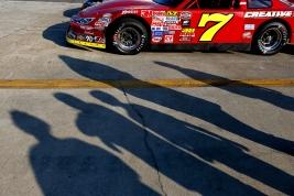 Fans walk around Michael Hardin's car before the start of Saturday's Hampton Heat at Langley Speedway.