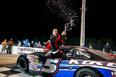 Lee Pulliam celebrates after winning the during Hampton Heat 200 Saturday at Langley Speedway.