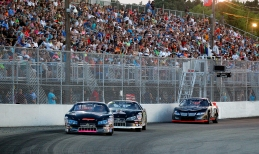 Fans fill the stands as Grand Stocks race around the track during the Hampton Heat Saturday at Langley Speedway.