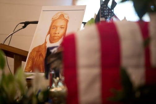 A photo of Tuskegee Airman William R. White stands next to his casket during a memorial service at Little Zion Baptist Church on Thursday in Smithfield, Va. (Kaitlin McKeown)