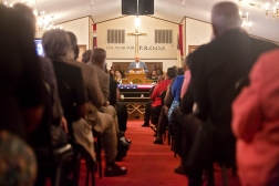 Mourners crowd the sanctuary at Little Zion Baptist Church as Bobby Bowser, pastor of Mount Lebanon Baptist Church in Norfolk, speaks during a memorial service for Tuskegee Airman William R. White on Thursday in Smithfield, Va. (Kaitlin McKeown)