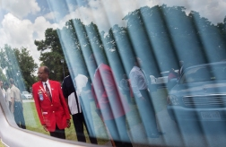 Members of Tuskegee Airmen, Inc. are reflected in the glass of a hearse following a memorial service for Tuskegee Airman William R. White at Little Zion Baptist Church on Thursday in Smithfield, Va. (Kaitlin McKeown)