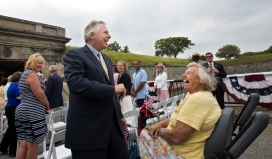 "Gov. Terry McAuliffe greets Fort Monroe resident Marguerite Stankus prior to a deed signing ceremony for the transfer of lands to the National Park Service on Tuesday at Fort Monroe. Stankus said she was pleased to see the area receive recognition. ""If it's a joint effort to preserve this place for a long time, then we've accomplished what we need to accomplish,"" she said. ""It's a remarkable place if you just take the time to look at it—there's no other place in the whole world like it."""