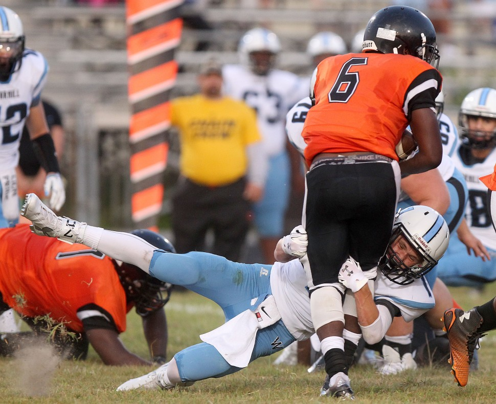 Warhill's Bryson Dannawitz drops Churchland's Jamil Edwards for a loss during the second quarter Thursday at Churchland.