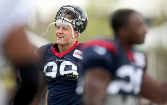 Houston Texans' J.J. Watt gets ready for practice with the Washington Redskins Thursday morning in Richmond.
