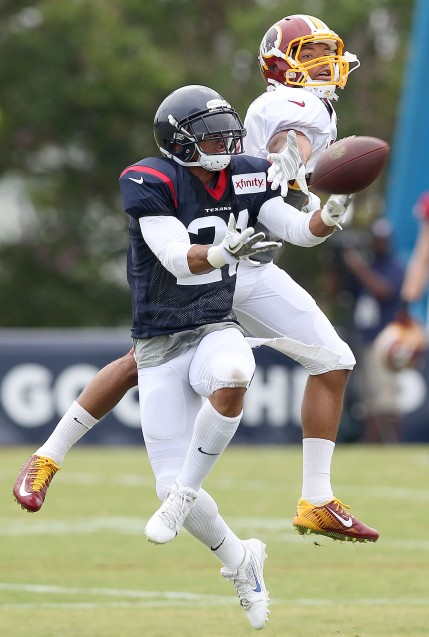 Houston Texans' corner back Darryl Morris almost intercepts this pass intended for Redskins wide receiver Tony Jones during training camp Thursday in Richmond.