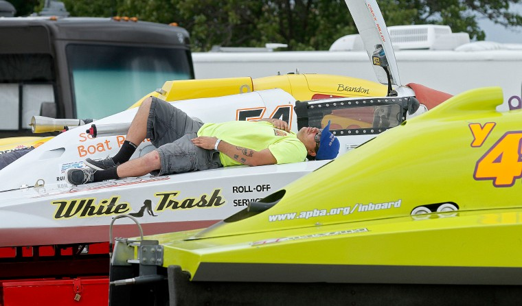 Mechanic Hans Dietrich takes a nap on a 5 Liter class racing boat Saturday as the racers wait for the winds to come down so they could race. The regatta was called off around three in the afternoon due to high winds. The race will pick up again Sunday morning around 9 A.M.