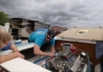 Mechanic Joe VanHook works on a Jersey Skiff class racing boat driven by Tom Petterson Saturday as they wait for the weather to break at the Hampton Cup Regatta. The race was called up around 3 due to high winds and racing will start again Sunday at 9 A.M.