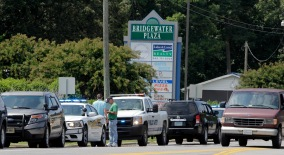 Police cars are parked at Bridgewater Plaza on Smith Mountain Lake on August 26, 2015 in Moneta, Virginia. Two employees of WDBJ TV were killed this morning during a live broadcast. The victims have been identified as reporter Alison Parker and camerman Adam Ward. Parker, 24 and Ward, 27, worked for WDBJ in Roanoke, Virginia. The suspect, Vester Lee Flanigan, also known as Bryce Williams, died of a self-inflicted gunshot wound. (Photo by Jay Paul/Getty Images)