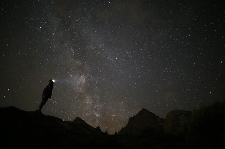 A photographer prepares to take pictures of the annual Perseid meteor shower in the village of Crissolo, near Cuneo, in the Monviso Alps region of northern Italy, on August 13, 2015. The Perseid meteor shower occurs every year when the Earth passes through the cloud of debris left by Comet Swift-Tuttle. AFP PHOTO / MARCO BERTORELLOMARCO BERTORELLO/AFP/Getty Images ORG XMIT: -