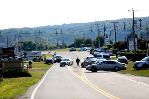Authorities block Booker T. Washington Highway at Bridgewater Plaza, Wednesday, Aug. 26, 2015, in Moneta, Va., after two journalists were fatally shot while broadcasting live from the plaza earlier in the day. (Stephanie Klein-Davis/The Roanoke Times via AP)