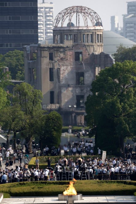 Atomic Bomb Dome is seen during the ceremony to mark the 70th anniversary of the bombing at the Hiroshima Peace Memorial Park in Hiroshima, western Japan Thursday, Aug. 6, 2015. (AP Photo/Eugene Hoshiko)