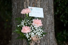 Flowers from viewer Rodney Booth, of Roanoke, Va., lie outside WDBJ's Digital Broadcast Center, in Roanoke, Va., Wednesday, Aug. 26, 2015. Two of the station's journalists were fatally shot while doing an on-air broadcast earlier in the day at Bridgewater Plaza in Moneta, Va. (Erica Yoon/The Roanoke Times via AP)