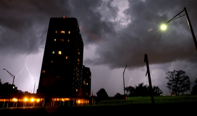 Lightning strikes near the Windward Tower apartment building as a pop-up thunderstorm moves through Newport News Thursday night. (Rob Ostermaier)