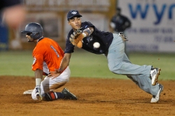 Peninsula Pilots' Garrett Brooks, left, slides safely into second base for a double as Wilmington Sharks' Kennard McDowell dives for the ball during Wednesday's playoff game at War Memorial Stadium.