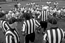 Referees talk with Woodside players before the start of a scrimmage against York Thursday evening.
