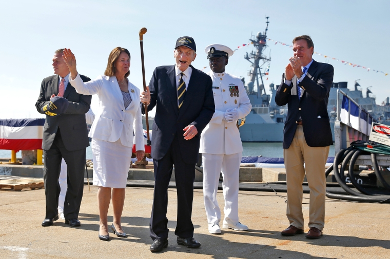 John Warner, center, acknowledges the audience before the commissioning of the submarine USS John Warner at Naval Station Norfolk Saturday morning August 1, 2015. From left is Governor of Virginia Terry McAuliffe, Jeanne Warner, John Warner, Senior Chief Oscar Veneszee and Senator Mark Warner.