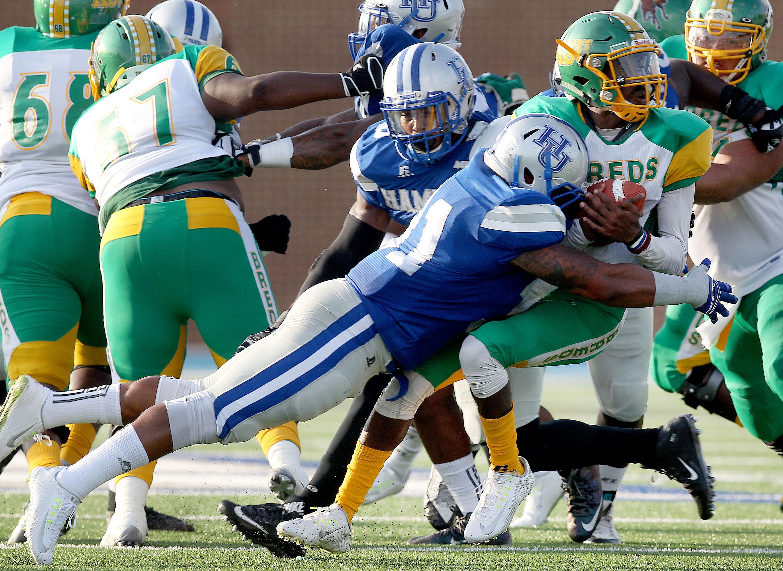 Hampton's Keith McAfee flies in to sack Kentucky State quarterback Ora