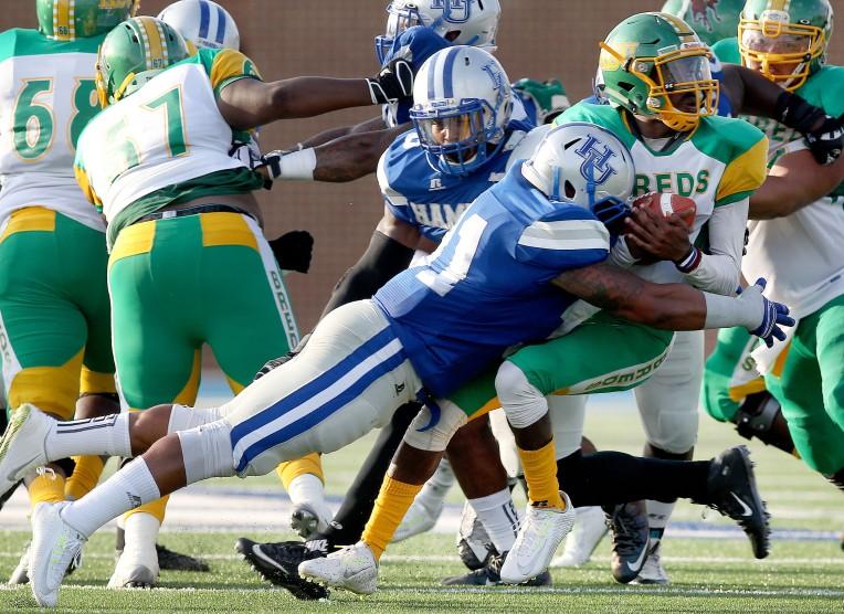 Hampton's Keith McAfee flies in to sack Kentucky State quarterback Ora Johnson during the first quarter Saturday at Hampton University.