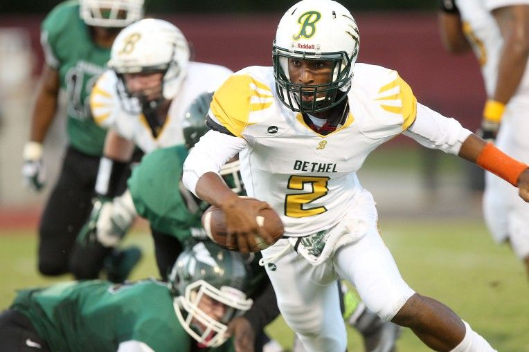 Bethel quarterback Lekendrell Lowther scrambles for a few yards during the first quarter Friday against Kecoughtan September 18, 2015.