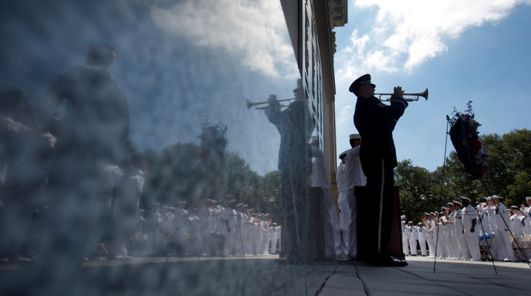 Tech Sgt. Dooley plays TAPS at the conclusion of a commemorative 911 ceremony Friday, September 11, 2015 at the Victory Arch in Newport News held by the USS Abraham Lincoln. (Adrin Snider)
