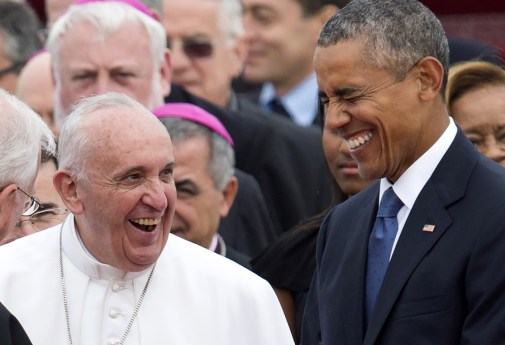 Pope Francis laughs alongside US President Barack Obama upon arrival at Andrews Air Force Base in Maryland, September 22, 2015, on the start of a 3-day trip to Washington. AFP PHOTO / SAUL LOEBSAUL LOEB/AFP/Getty Images
