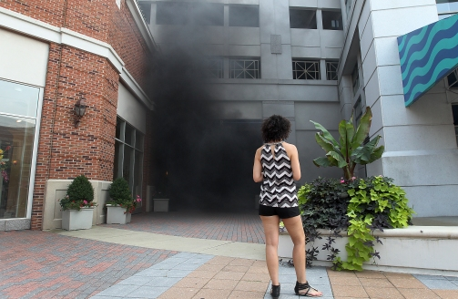 Thick black smoke bellows from the parking structure on Mariners Row in City Center from a burning van Thursday. (Photo by Rob Ostermaier/Daily Press)