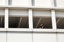 A firefighter responds to the scene of fire inside the parking structure on Mariners Row in City Center Thursday afternoon. (Photo by Jonathon Gruenke/Daily Press)