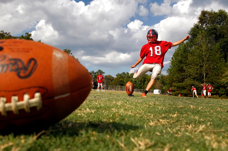 Grafton kicker Reed King practices kickoffs Wednesday afternoon September 9, 2015. During last week's game against Churchland, Reed scored with field goals from 43 and 23 yards. (Jonathon Gruenke)