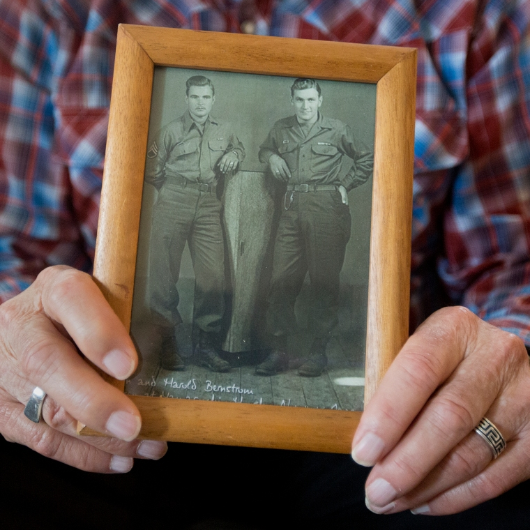 Hampton resident and World War II veteran Ken Bernstrom holds a photo of himself and his older brother, Harold, taken Nov. 11, 1945 in Yamaguchi, Honshu in Japan. The brothers both served in the 128th Infantry Regiment during World War II. (Kaitlin McKeown)