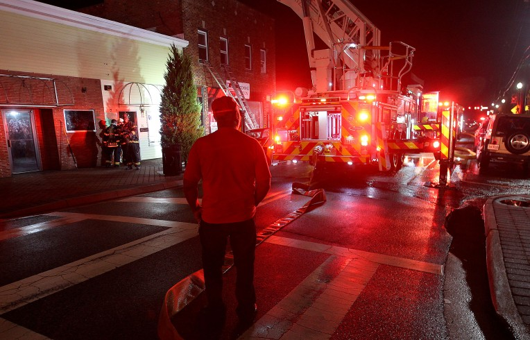 Hampton fire personnel were called to East Mellen St. in Phoebus for a fire in one of the buildings near the intersection of Hope St. Tuesday night. (Rob Ostermaier)