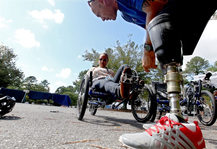 Army veteran Stephanie Carraway is fitted for a trike by bike tech Bobby Puckett for the Soldier Ride taking place Friday and Saturday. The ride brings together wounded service men and women for a ride a fellowship with their fellow military personnel. (Rob Ostermaier)
