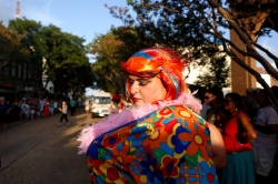 Michael Biggins waits before participating in the Drag Race on Queens Way during Saturday's Hampton Block Party. Four teams representing different charities ran down Queens Way in heats.