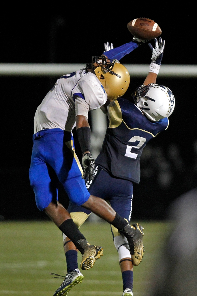 Smithfield's Chris Pierce, left, just misses catching the ball over Lafayette's Hezekiah Grimsley during Friday's game at Wanner Stadium on September 18, 2015.