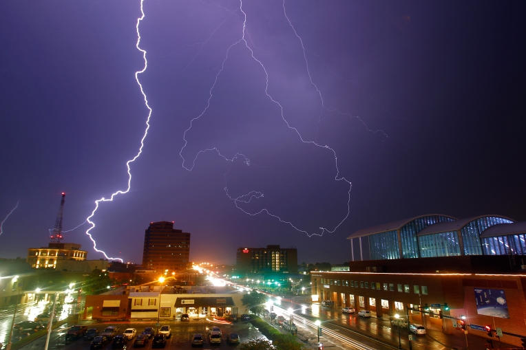 Lightning flashes over downtown Hampton Thursday evening as a severe storms move through the area on September 10, 2015.
