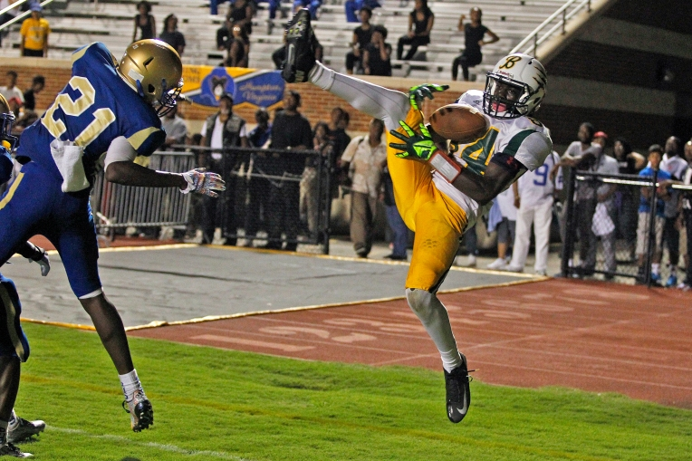 Bethel's Elijah Parker, right, catches the ball over Phoebus' Johnathan Gregory, left, but lands out of bounds during Friday's game at Darling Stadium on September 4, 2015.