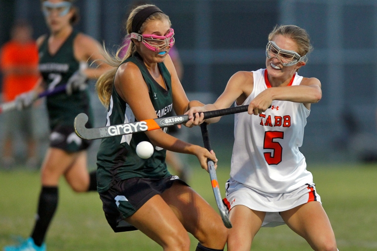 Tabb's Stephanie Martin, right, battles for control with Jamestown's Julia Haupt during Tuesday's game on September 15, 2015.