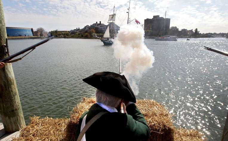 Reenacts portraying the 1st and 2nd Virginia take aim at a British ship making its way up the Hampton River during a recreation on the Battle of Hampton Saturday.
