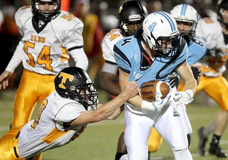Tabb's Alex Wright drags down Warhill's Bryce Koob as he tries to run during the first quarter Friday October 30, 2015.