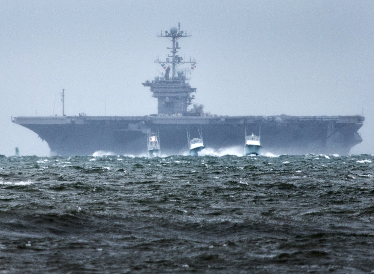 Boats head for safe berths ahead of the USS Harry S. Truman (CVN-75) as it returns to Norfolk, ahead of the approach of Hurricane Joaquin on Oct. 1, 2015. (Joe