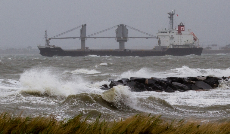 A ship enters the Chesapeake Bay out of Hampton Roads in the face of gusty winds and surging tides on Sunday around midday. (Adrin Snider)