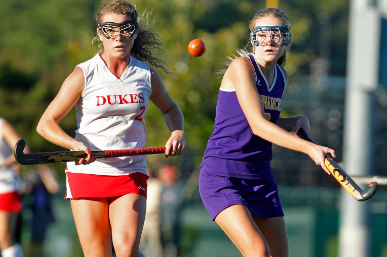 Gloucester's Cassidy Goodwin, left, and Menchville's Rebecca Cody look for the ball during Tuesday's game at Christopher Newport University October 6, 2015.
