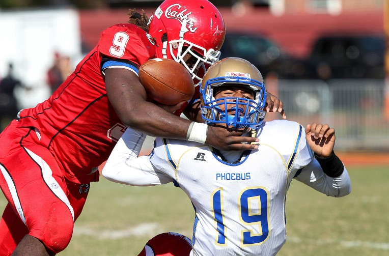 Hampton's Elijah Conliffe sacks Phoebus quarterback Justin Wright late in the second quarter Saturday October 17, 2015 at Darling Stadium.