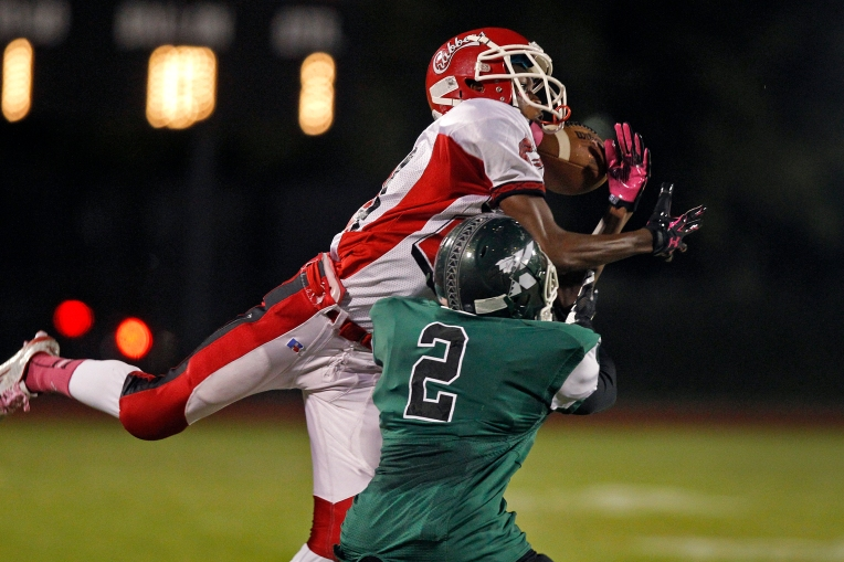 Hampton's Burnell Pulley can't hang onto a pass over Kecoughtan's Kevin Davis during Friday's game at Darling Stadium on October 9, 2015.