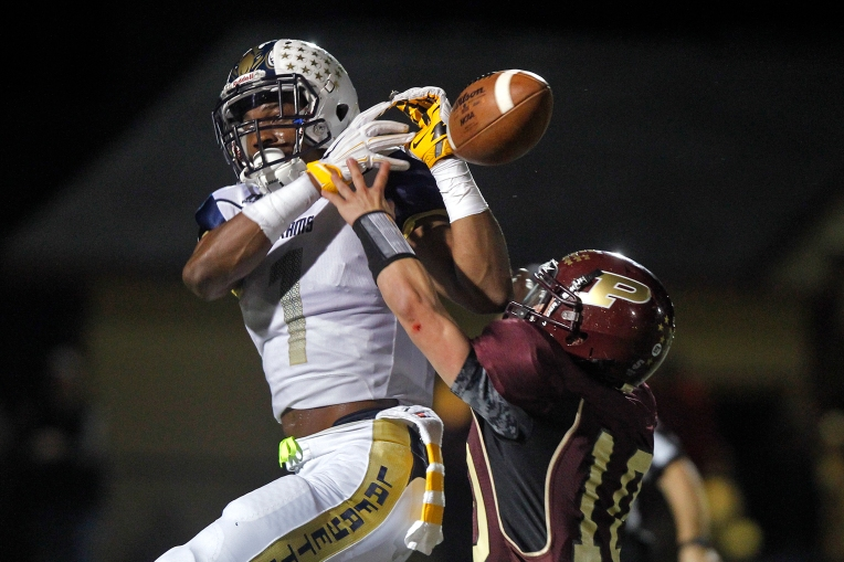 Poquoson's Trevor Dunagan, right, interferes with Lafayette's Tyrek Graham as he attempts to catch the ball during Thursday's game on October 15, 2015.